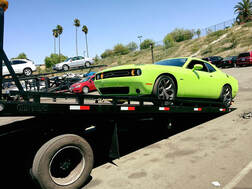 Picture of an exotic car being hauled by a tow truck in San Diego, California.